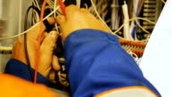 istock worker creates correct electrical circuit using scheme 1200812086