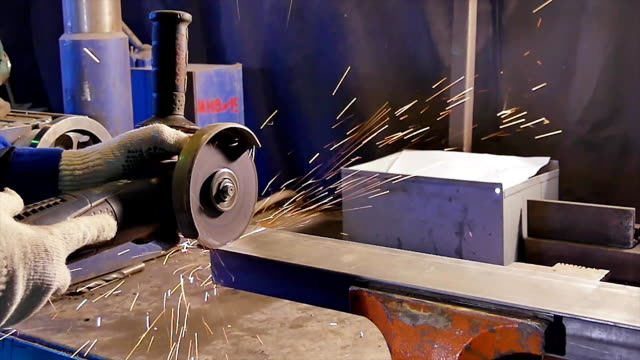 Worker cutting metal. Cutting metal angle grinder. Worker cutting metal with grinder. Sparks while grinding iron Worker cutting metal. Cutting metal angle grinder. Worker cutting metal with grinder. Sparks while grinding iron. handbook stock videos & royalty-free footage