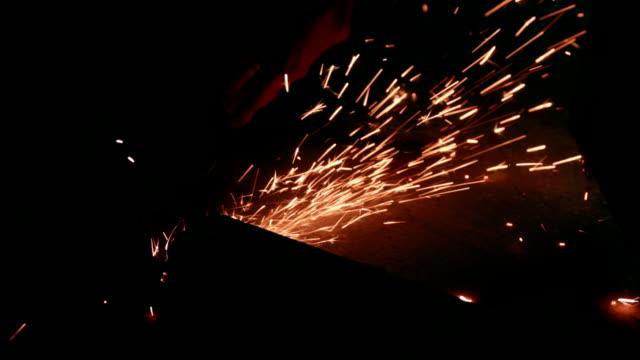worker cutting metal girder with angle grinder - spranga video stock e b–roll
