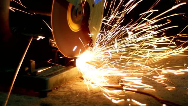 Worker cutting steel tube in workshop video