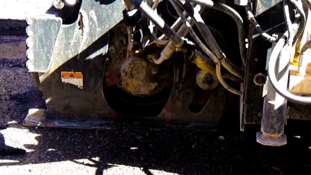 worker driver Skid steer remove Worn Asphalt during repairing Road Works video
