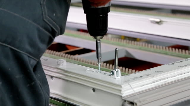 Worker fastens the accessories to plastic window video