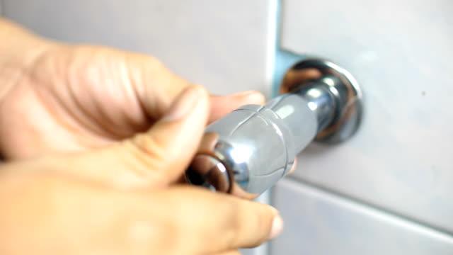 Worker Fixing Shower Value in Bathroom