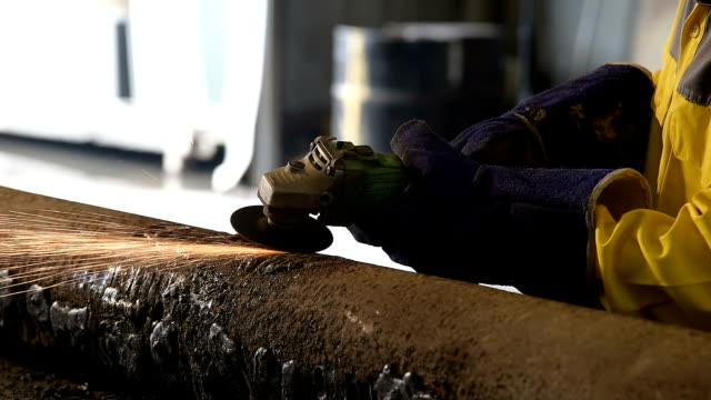 worker grinding in factory video