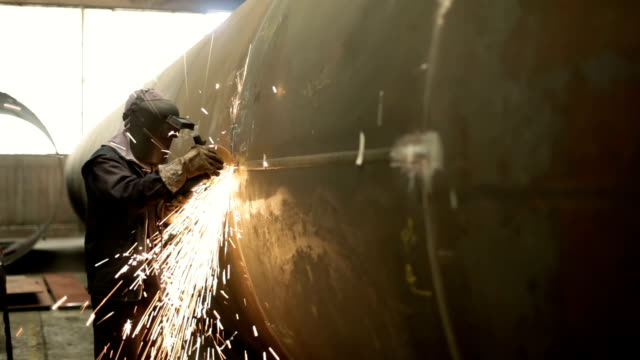 Worker Grinding Worker Grinding HD1080p grinder industrial equipment stock videos & royalty-free footage
