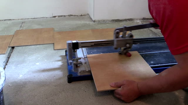 worker handyman cut tiles at work place with special tool video