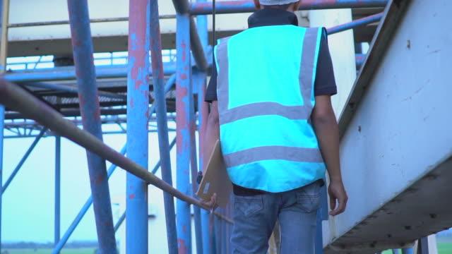 Worker in grain silo factory