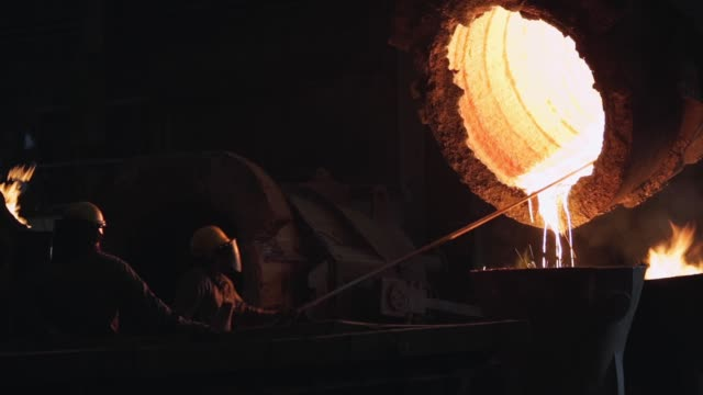 Worker In the Foundry.  Worker Controlling Iron Smelting. Worker In the Foundry.  Worker Controlling Iron Smelting. Full HD. steel mill stock videos & royalty-free footage