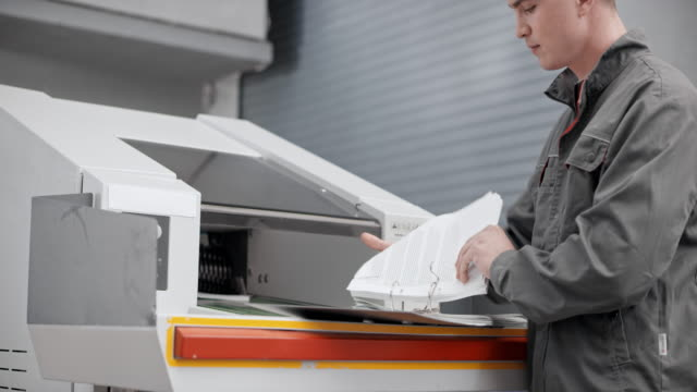 DS Worker inserting documents into an industrial shredder video