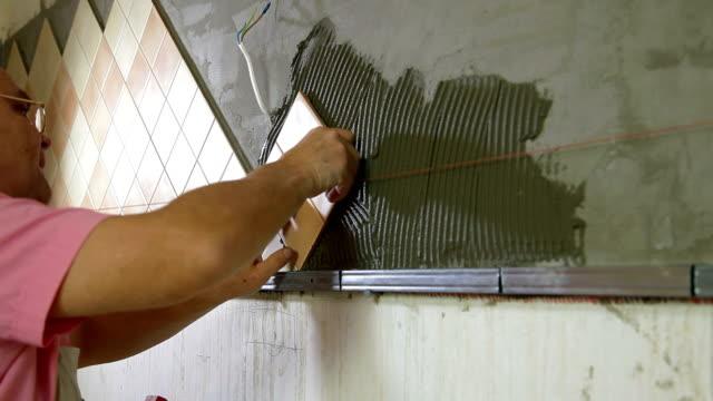 Worker installing Tile video
