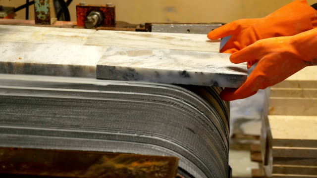 Worker is holding marble in production line in marble factory factory, industry, natural stone, granite, production line production line worker stock videos & royalty-free footage