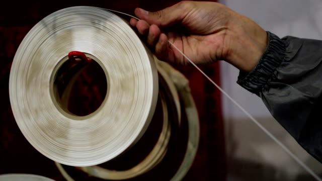 Worker man unrolling furniture tape at furniture workshop video
