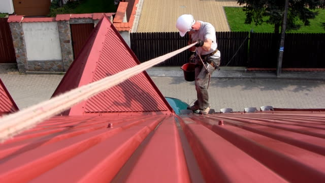 Worker on a roof video