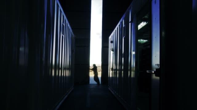 Worker Opening Metal Door of Hangar. Worker Opening Metal Door of Hangar.  Full HD. container stock videos & royalty-free footage