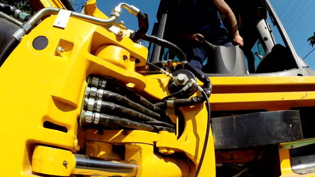 Worker Operates Heavy Machinery Beautiful yellow heavy machinery in action. HD1080p.GoPro HERO3. construction equipment stock videos & royalty-free footage
