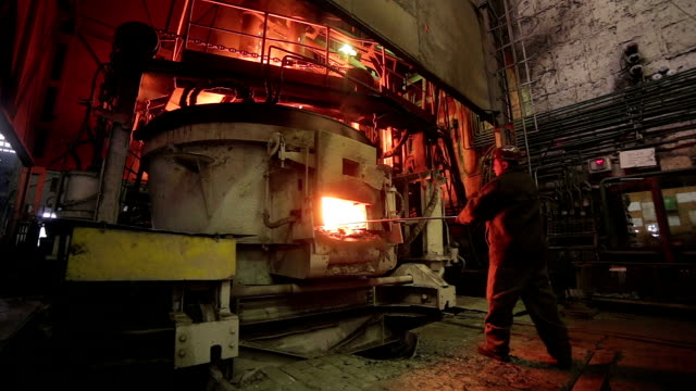 Worker operates in blast furnace workshop at the metallurgical plant video