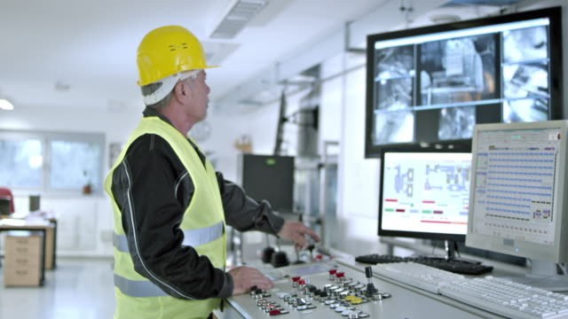 DS worker operating the recycling facility machines from control center video
