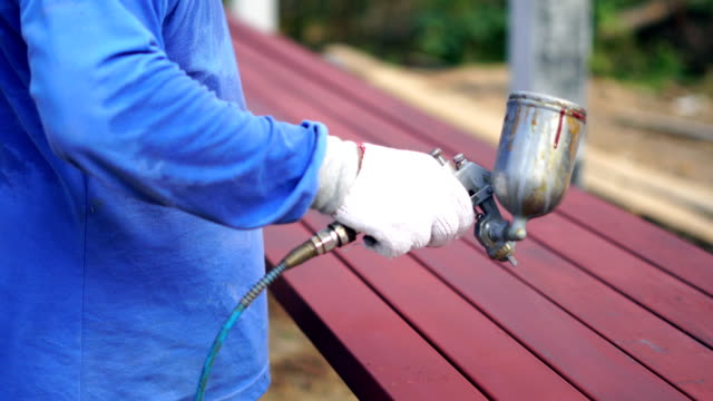 Worker painting on steel  surface by spray gun for protection rust and corrosion