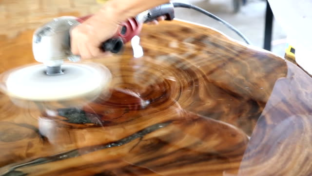 worker polishing wooden table. - levigatrice video stock e b–roll