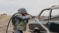 istock Worker sandblasting metal surface of car 1188850131