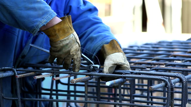 Worker Tying the Rebar on Constrution Site CU video