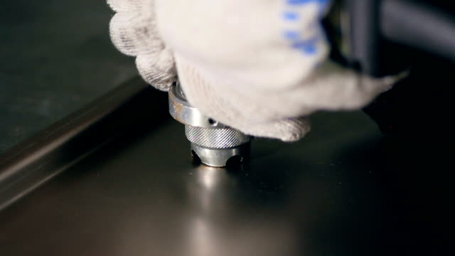 Worker using industrial riveter on metal. Slow motion. video
