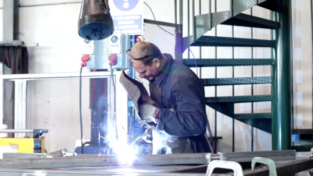 worker welding in a factory - dolly worker welding in a factory electrode stock videos & royalty-free footage