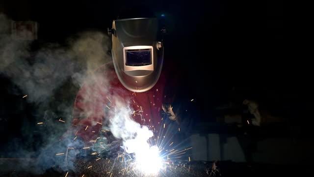 Worker welding the steel part video of Worker welding the steel part by manual in construction site metal worker stock videos & royalty-free footage