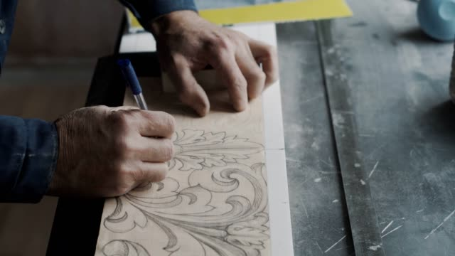 Worker without two phalanges on his arm, he traces lines on the fluted paper Stone Worker Room. Metal table on side craftsman architecture stock videos & royalty-free footage
