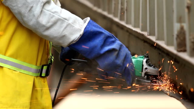 Worker work with grinder. video
