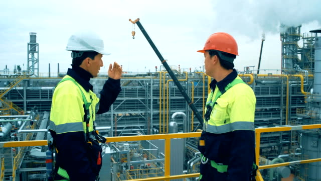 Workers in production plant as team discussing, industrial scene in background Workers in productio n plant as team discussing, industrial scene in background. international match stock videos & royalty-free footage