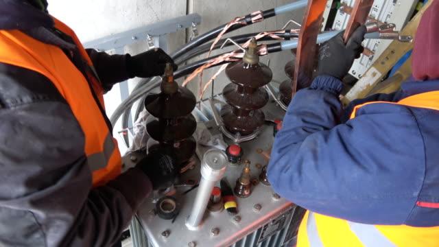 workers in the electric site - sottostazione elettrica video stock e b–roll
