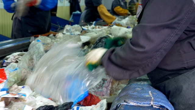 4k. workers sorting garbage to be processed in a recycling plant. - recycling stock videos & royalty-free footage