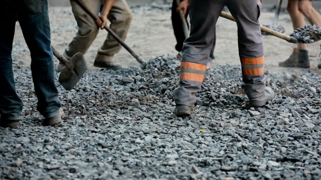 Workers Throw Gravel With Shovels video