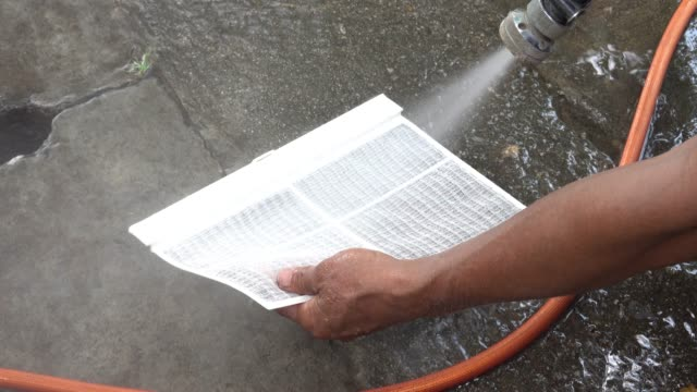 4K Workers use high pressure hose to clean the air filter.