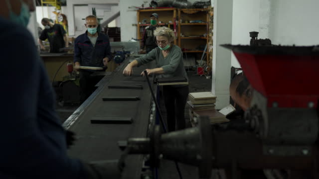 Workers working on coal for hookah production line in factory Group of people. workers working on coal for hookah production line in factory. production line worker stock videos & royalty-free footage