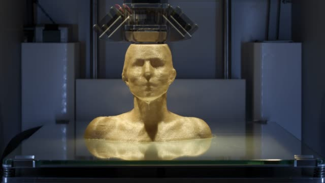 Working 3D printer, printing a female bust - Symbol for Industry 4.0