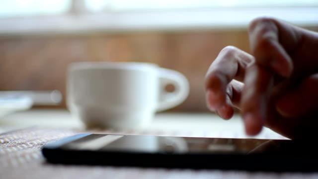 working and drink coffee. - sabah stok videoları ve detay görüntü çekimi