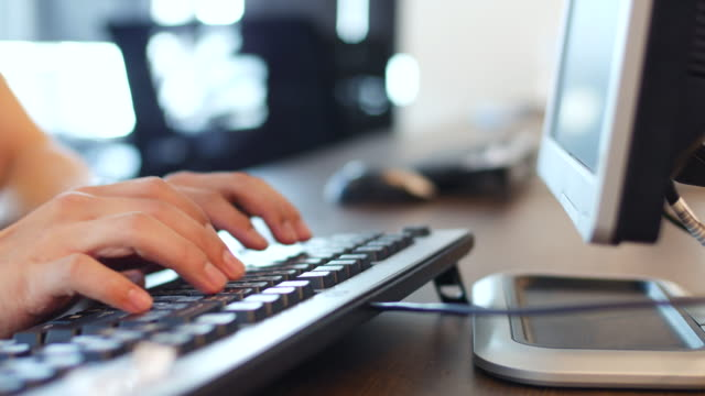 Working at a desk with a computer keyboard