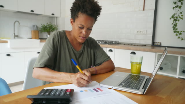working at home. - financial planning stock videos and b-roll footage