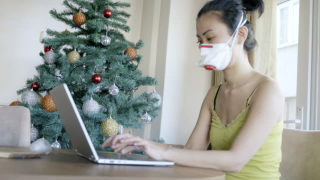 working at home with face mask protection of coronavirus covid-19 in quarantine curfew - torace animale video stock e b–roll