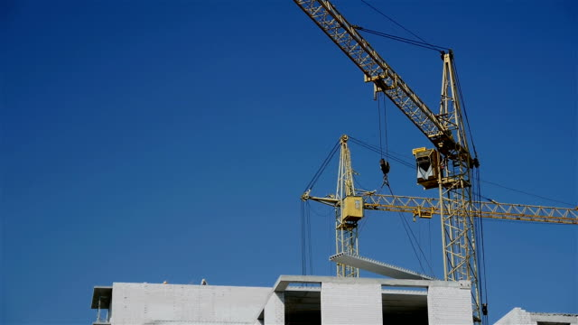 Working construction cranes. video