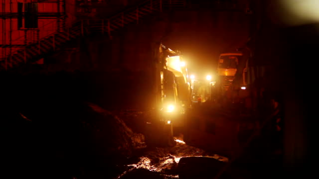 Working construction site machines at night, tractors, trucks Working construction site machines at night, tractors, trucks construction machinery stock videos & royalty-free footage