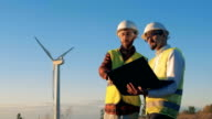 istock Working engineers look at a laptop in hands. Environmental energy concept. 1139734677