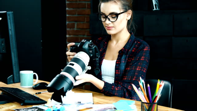 Working in office alone concept Working in office with huge proffessional camera, photographer concept only young women stock videos & royalty-free footage