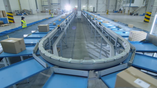 Working Large Belt Conveyor with Parcels at Sorting Post Office. video