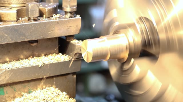 working lathe very close up at the factory - станок стоковые видео и кадры b-roll