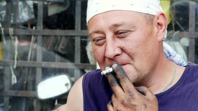 A Working Man Lit a Cigarette video