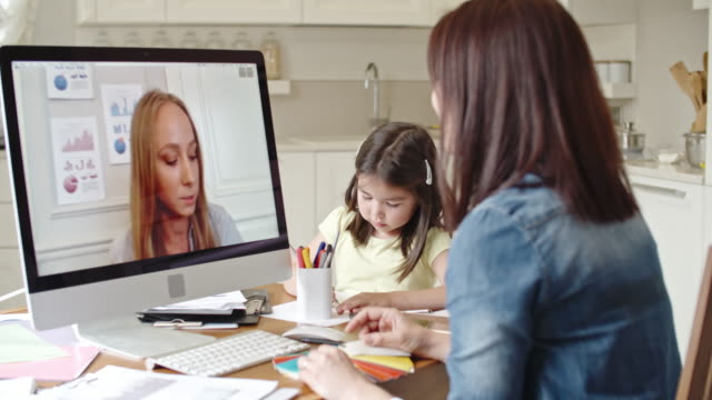Working mother discussing contract via video call video