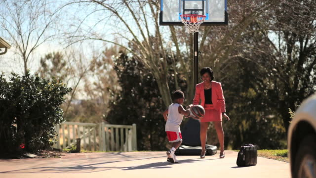 Working Mother Playing Basketball with Her Son video